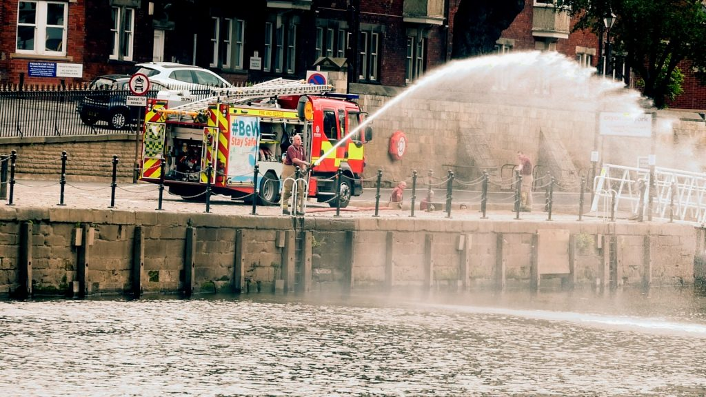 Fireman Practices his aim York River Ouse Walk
